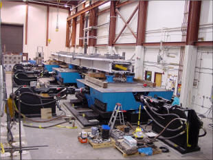 CAPTION:  Three shake tables at the University of Nevada Reno are used to investigate how this 40-percent scale model of a concrete slab-on-steel girder bridge responds to seismic stimuli. (Courtesy of Gokhan Pekcan, UNR.  See http://bric.ce.unr.edu/nees/.)